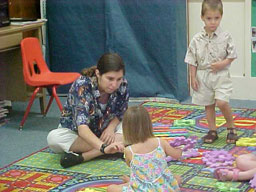 Employee working with two small children