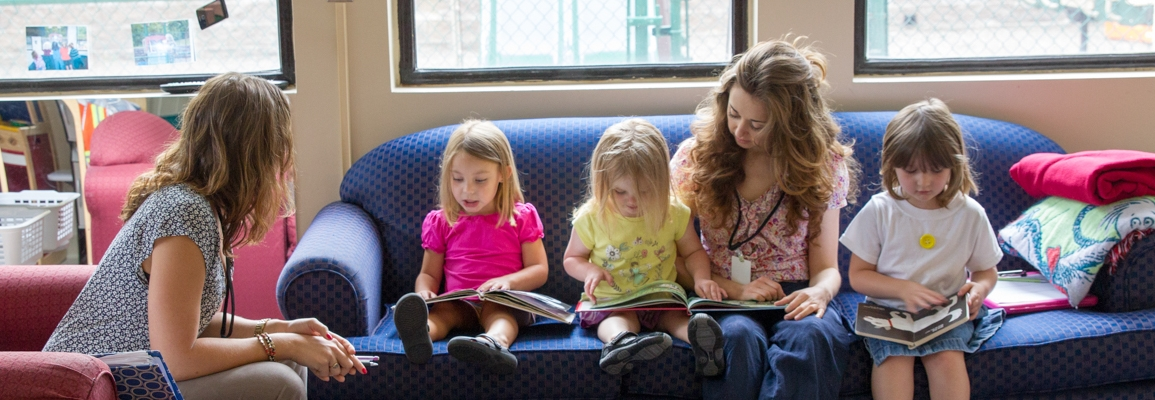 Clinical educators and children reading books